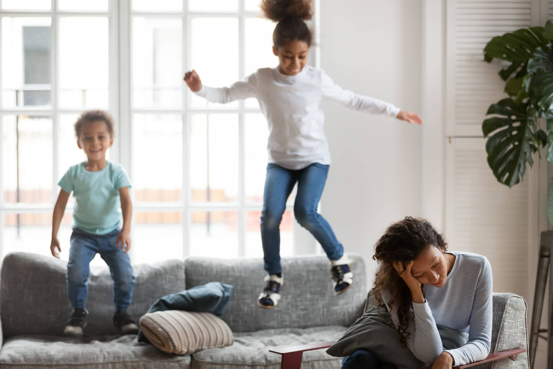 Exhausted mom ignoring misbehavior