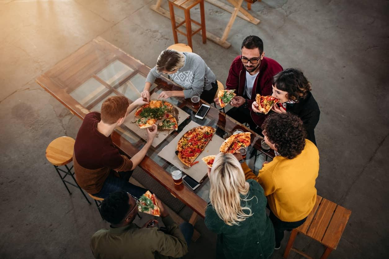 Friends having pizza at a restaurant
