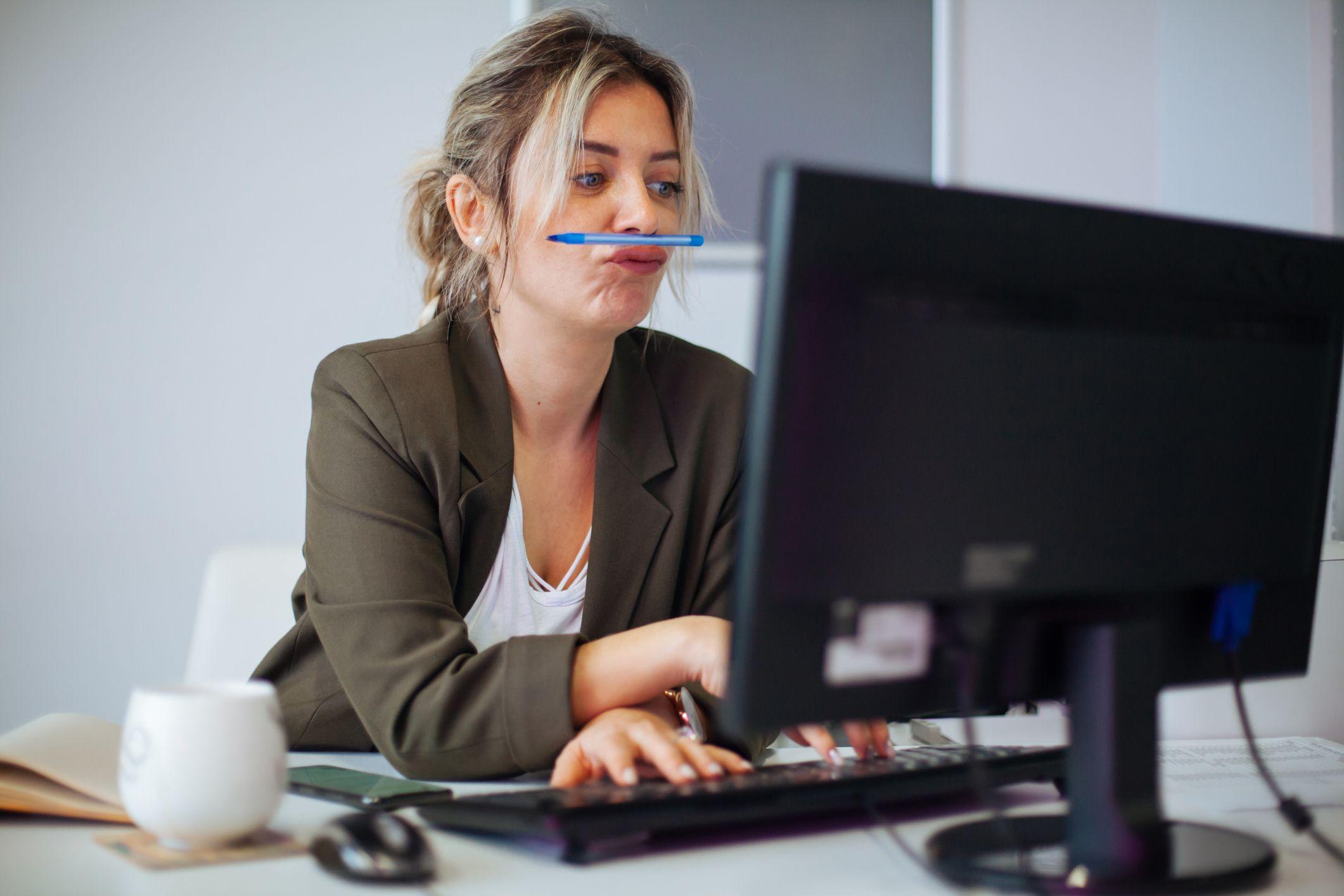 Woman procrastinating an important report