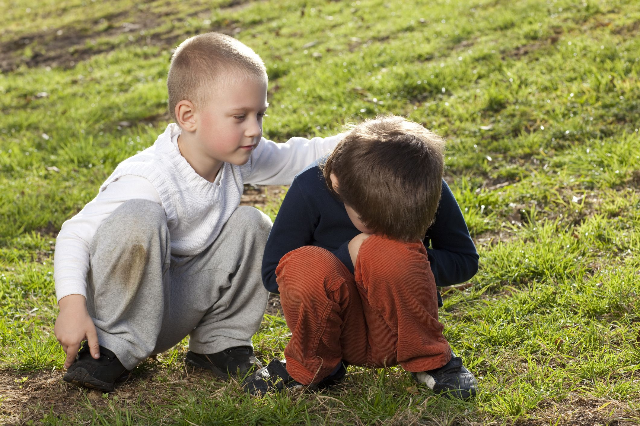 A little boy comforting his friend with empathy