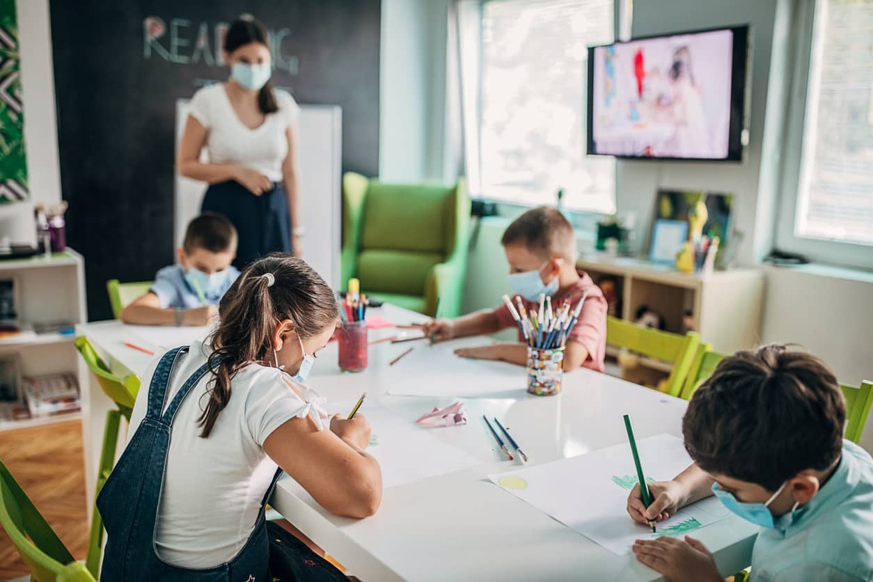 School classroom during COVID with kids wearing masks