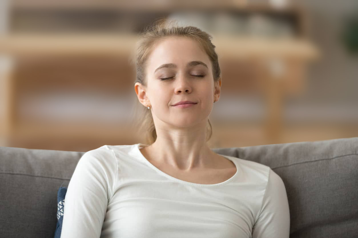 Woman breathing deeply to relax and destress