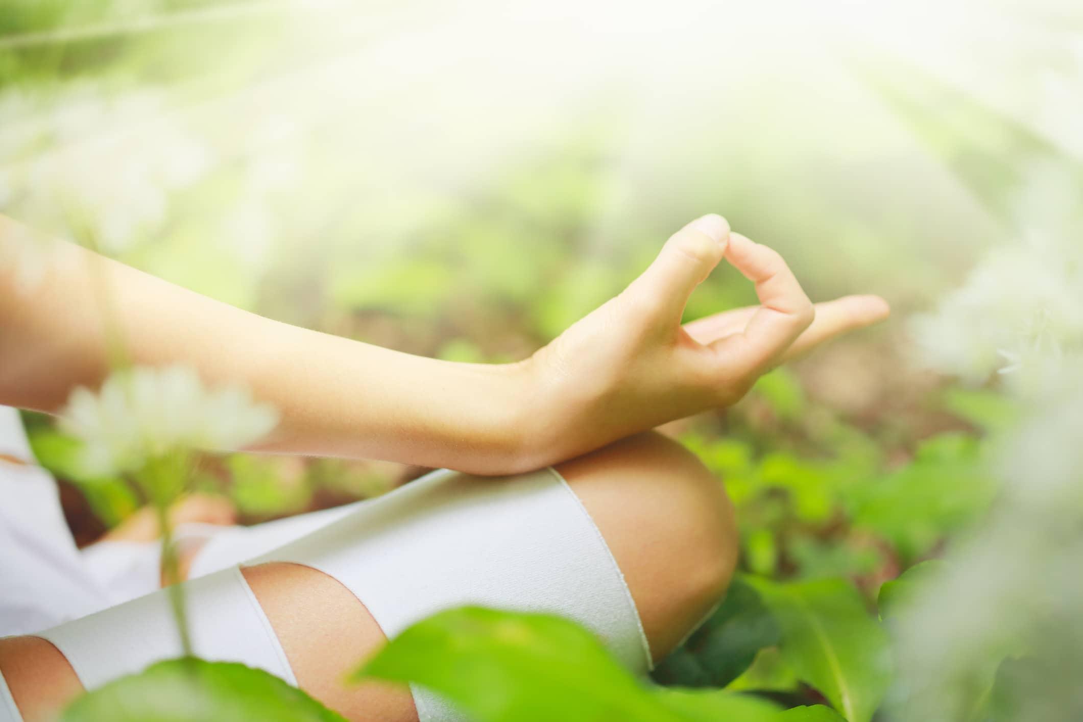 A woman sitting in meditation
