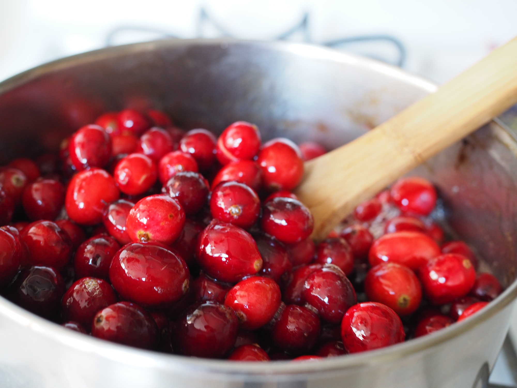Cranberries simmering in a sauce pan for the holidays