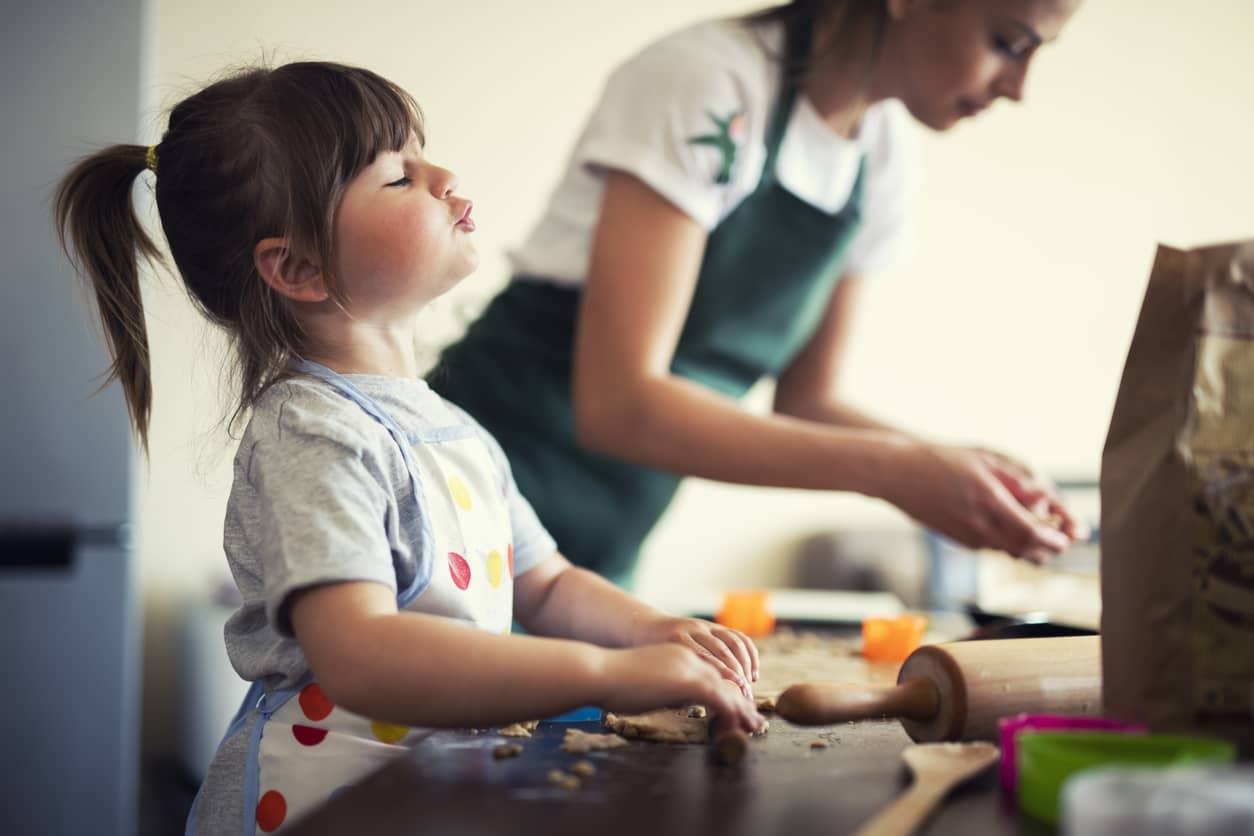 Stay-at-home mom baking with preschooler