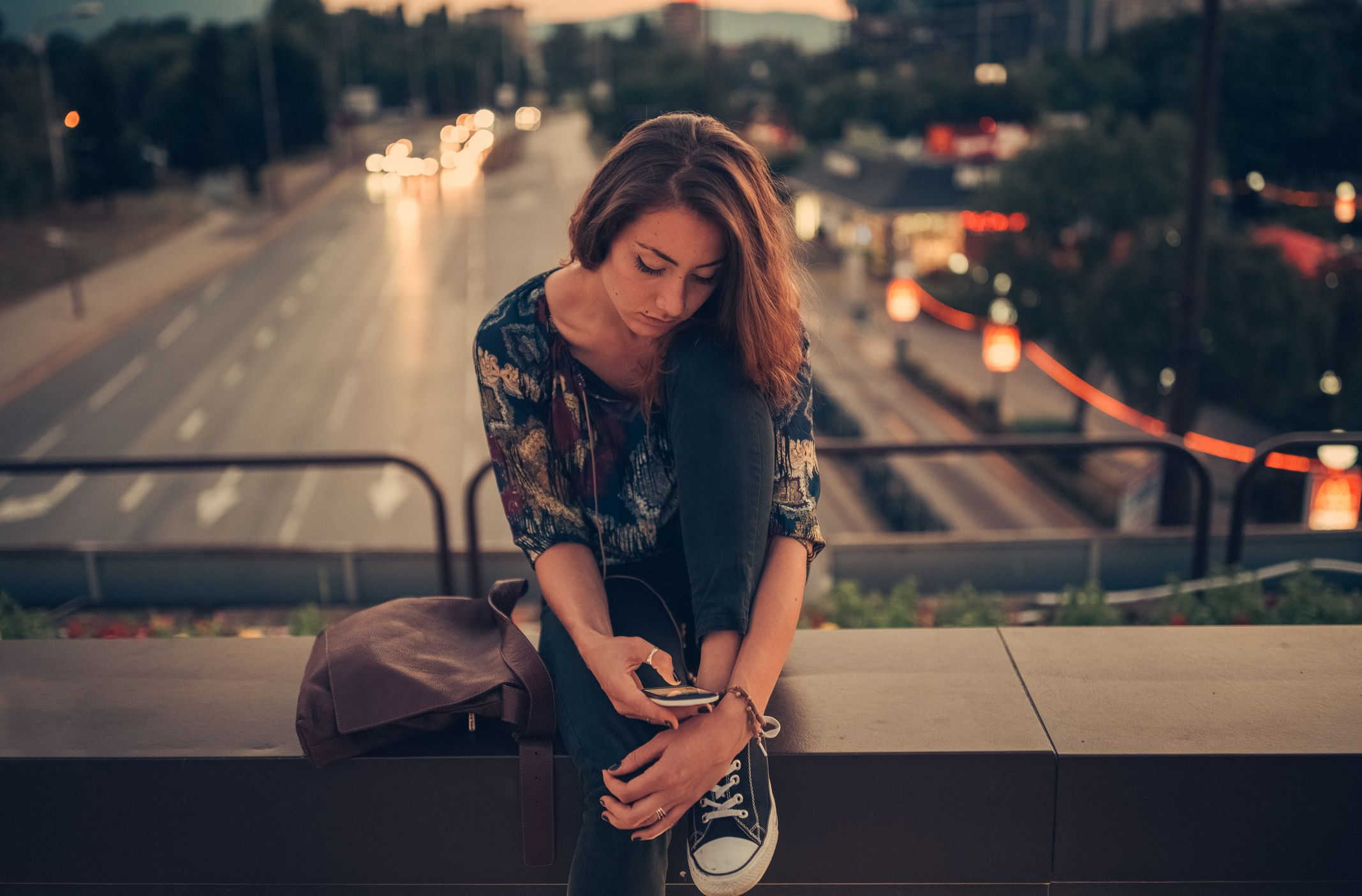 Depressed teenager texting