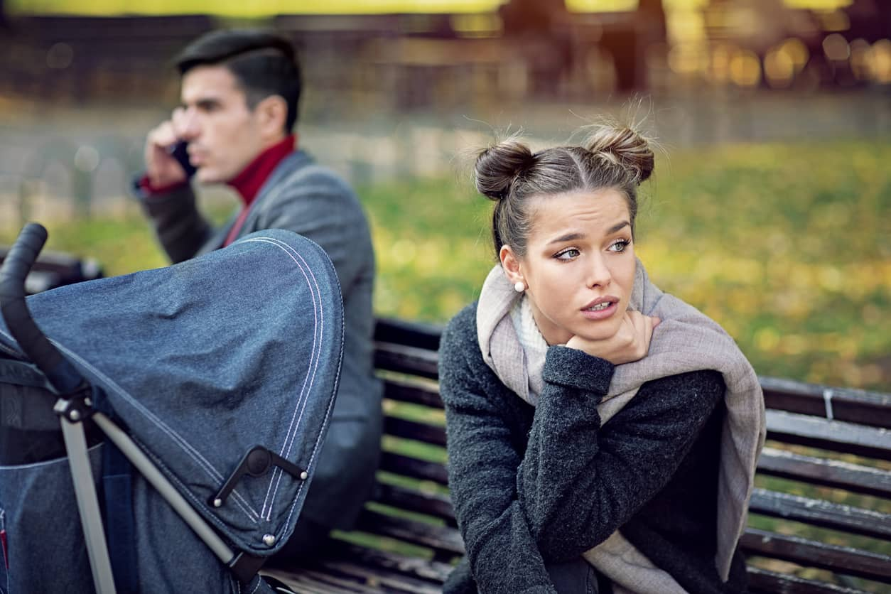 Frustrated spouse whose husband is talking on his iPhone