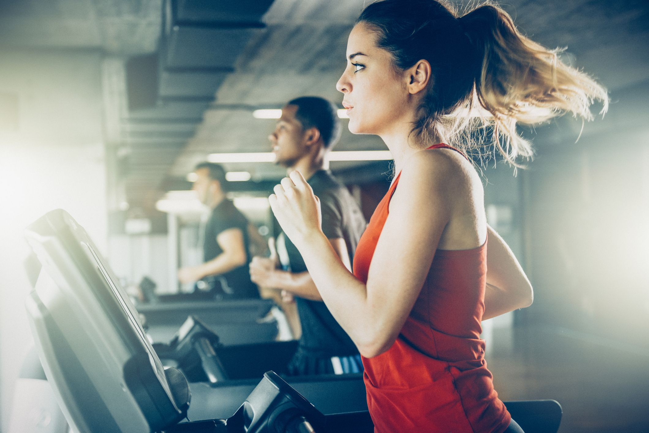 People working out on treadmill at a gym