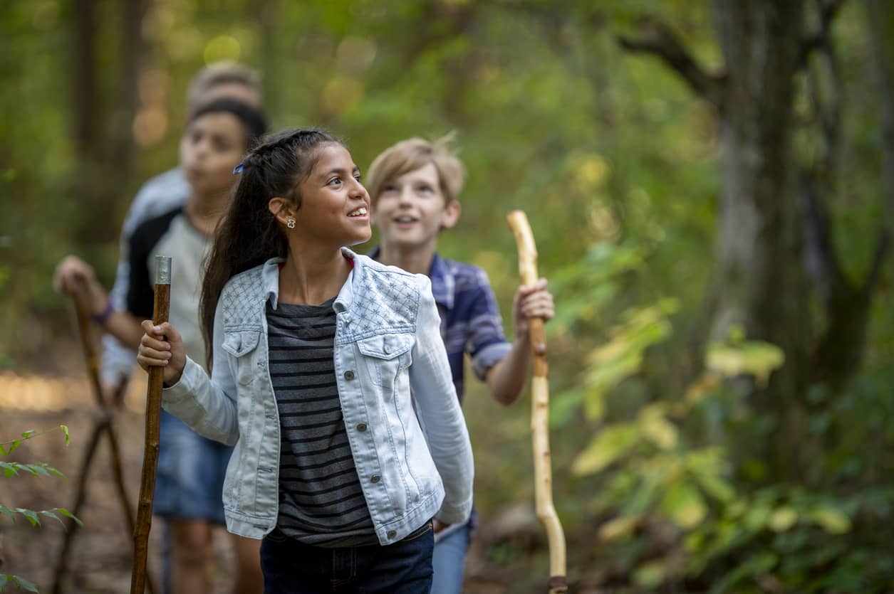 Elementary kids hiking; exercise is great for emotional regulation