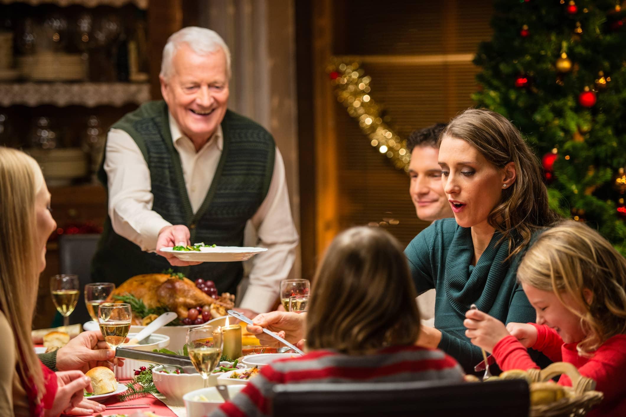 A blended family celebrating a Christmas dinner