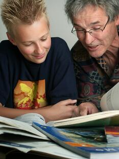 Father & son looking at books.jpg