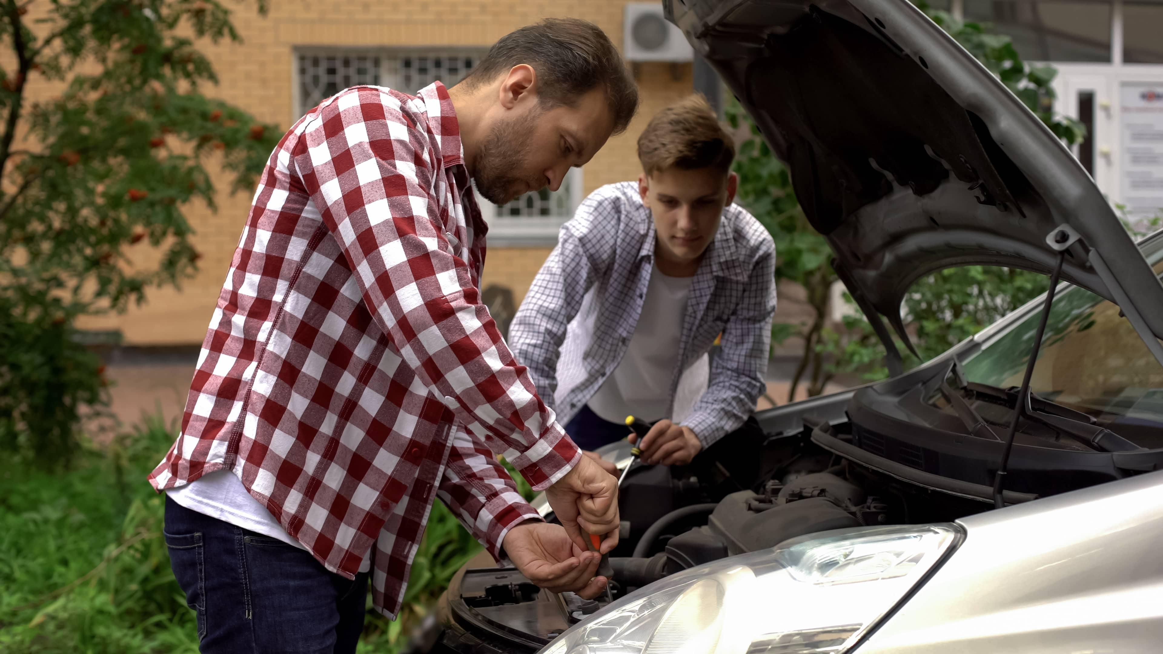Father teaching his son critical thinking through mechanics
