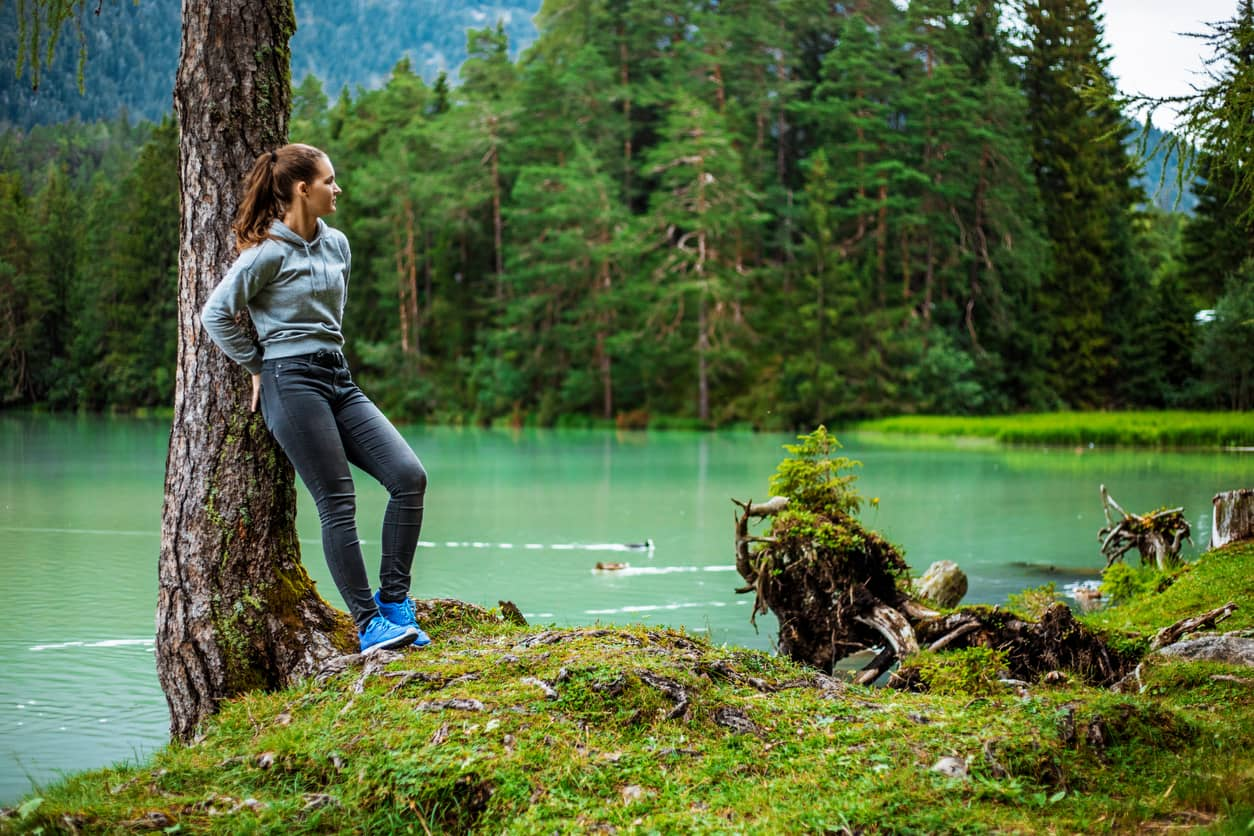 Young woman being present to nature's beauty