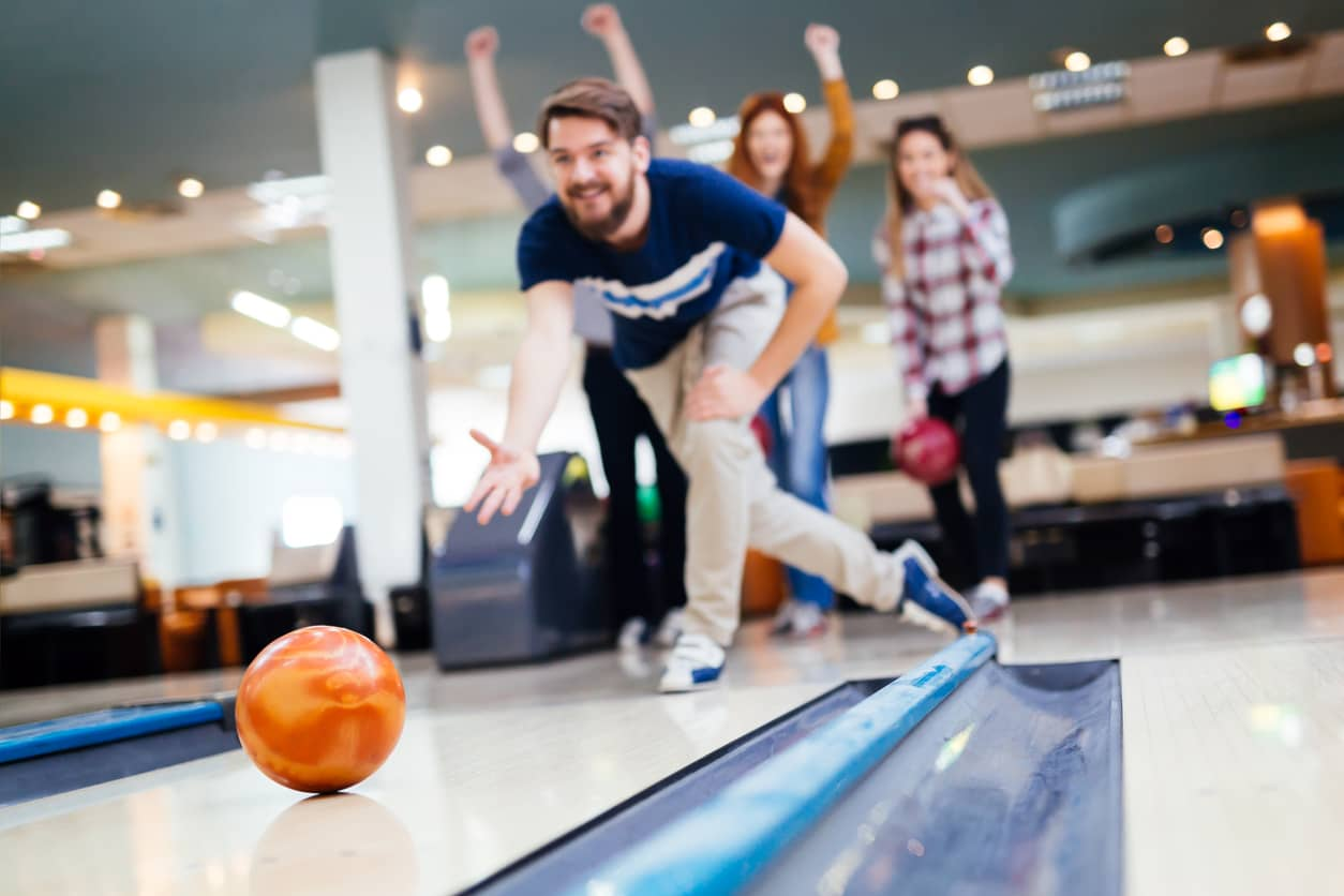Friends bowling and having fun together