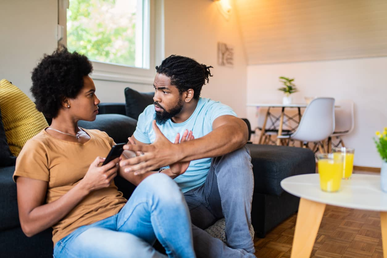 Frustrated black couple arguing and making emotional withdrawals