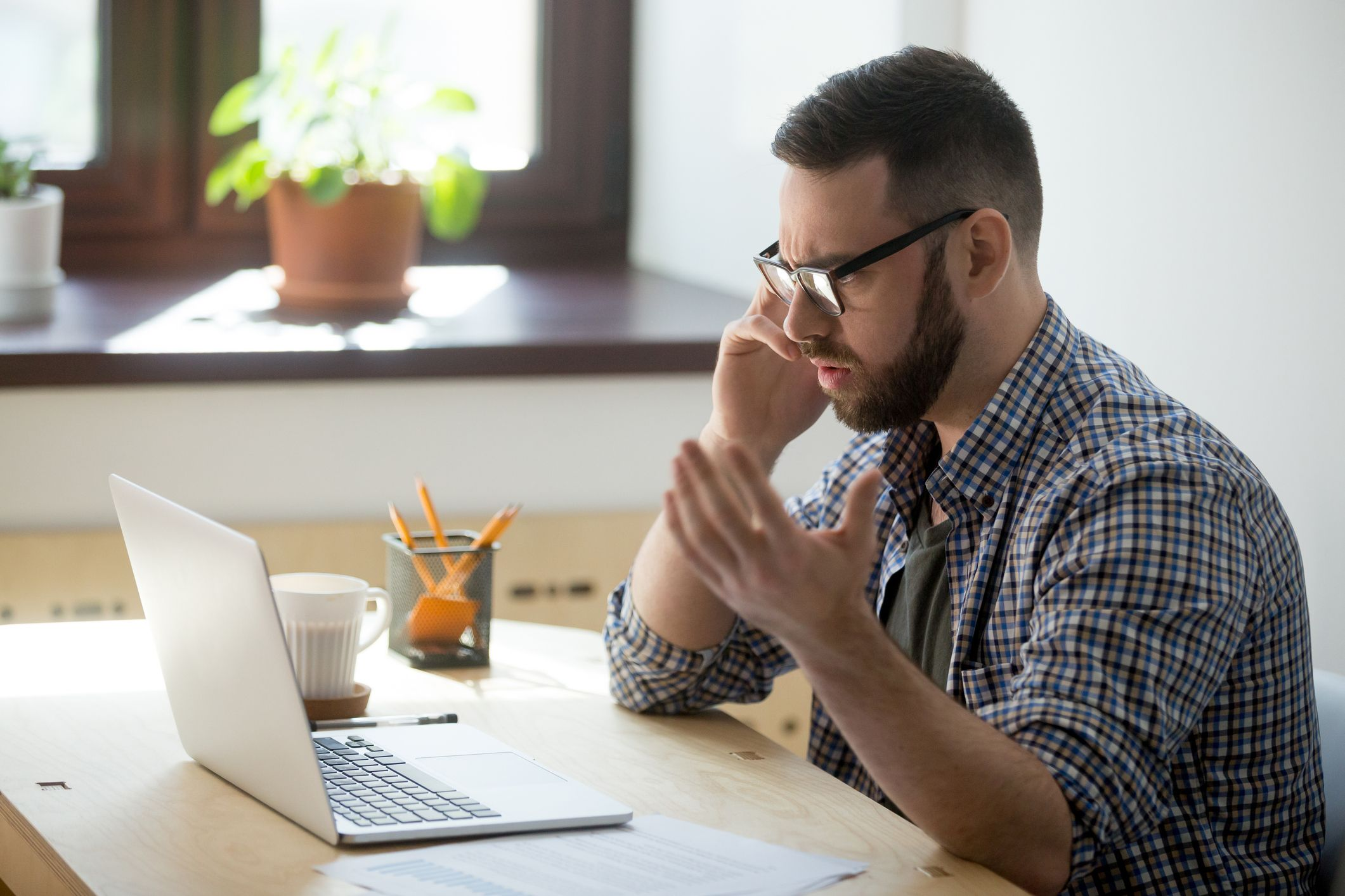 Frustrated man unable to control anger over the phone