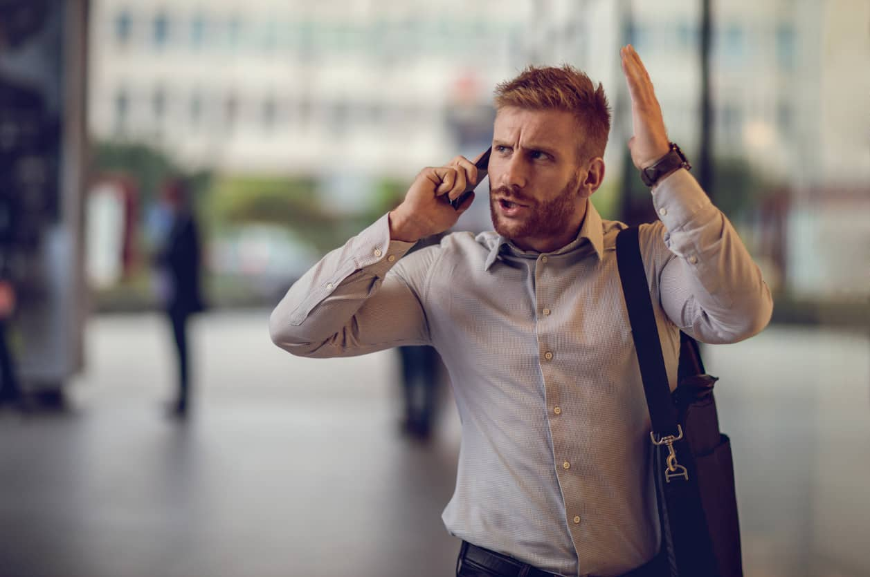 Angry man on a smartphone