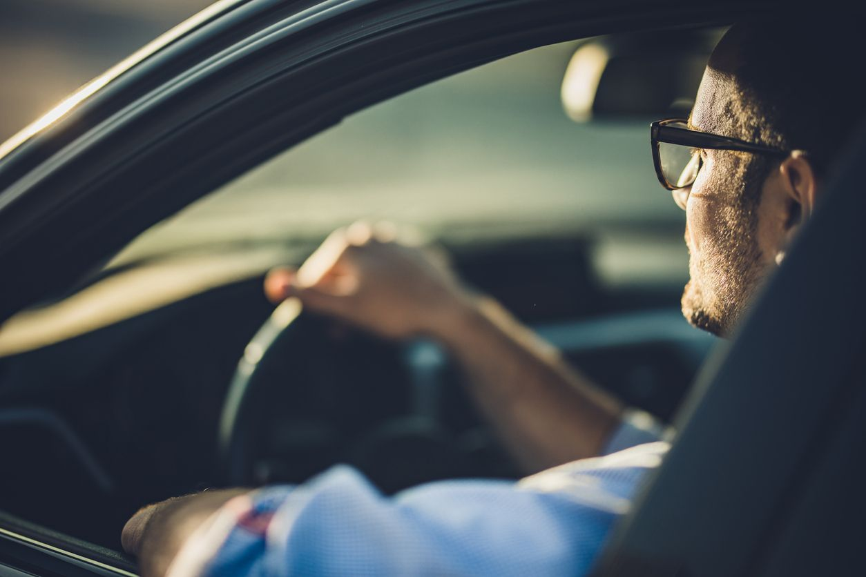 Man driving to work while setting a positive intention