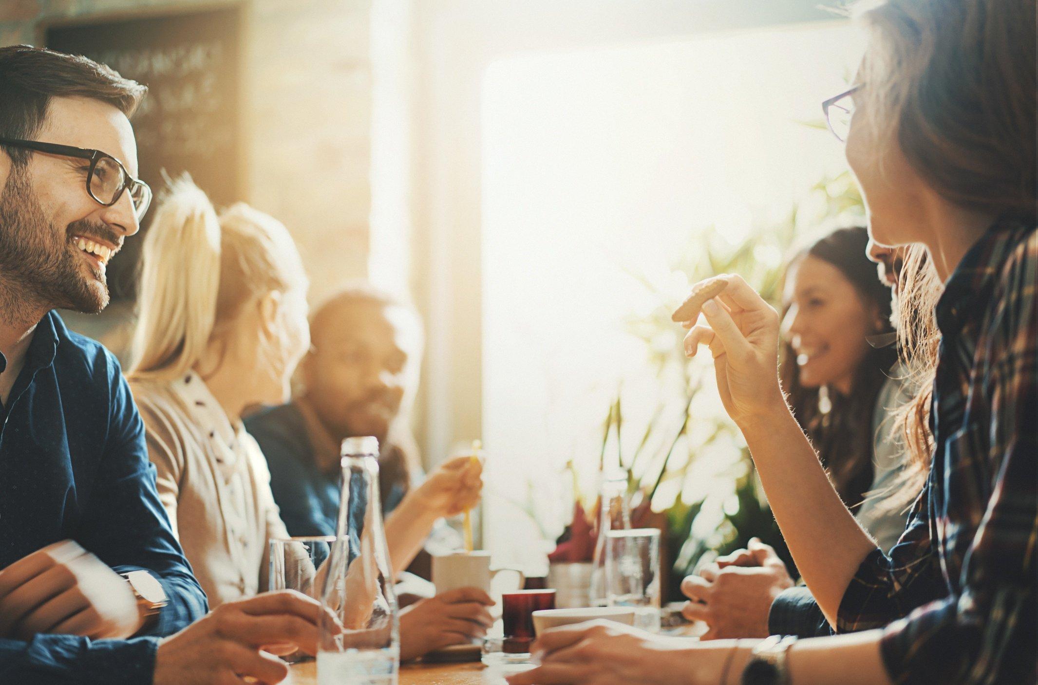 Friends at restaurant in conversation