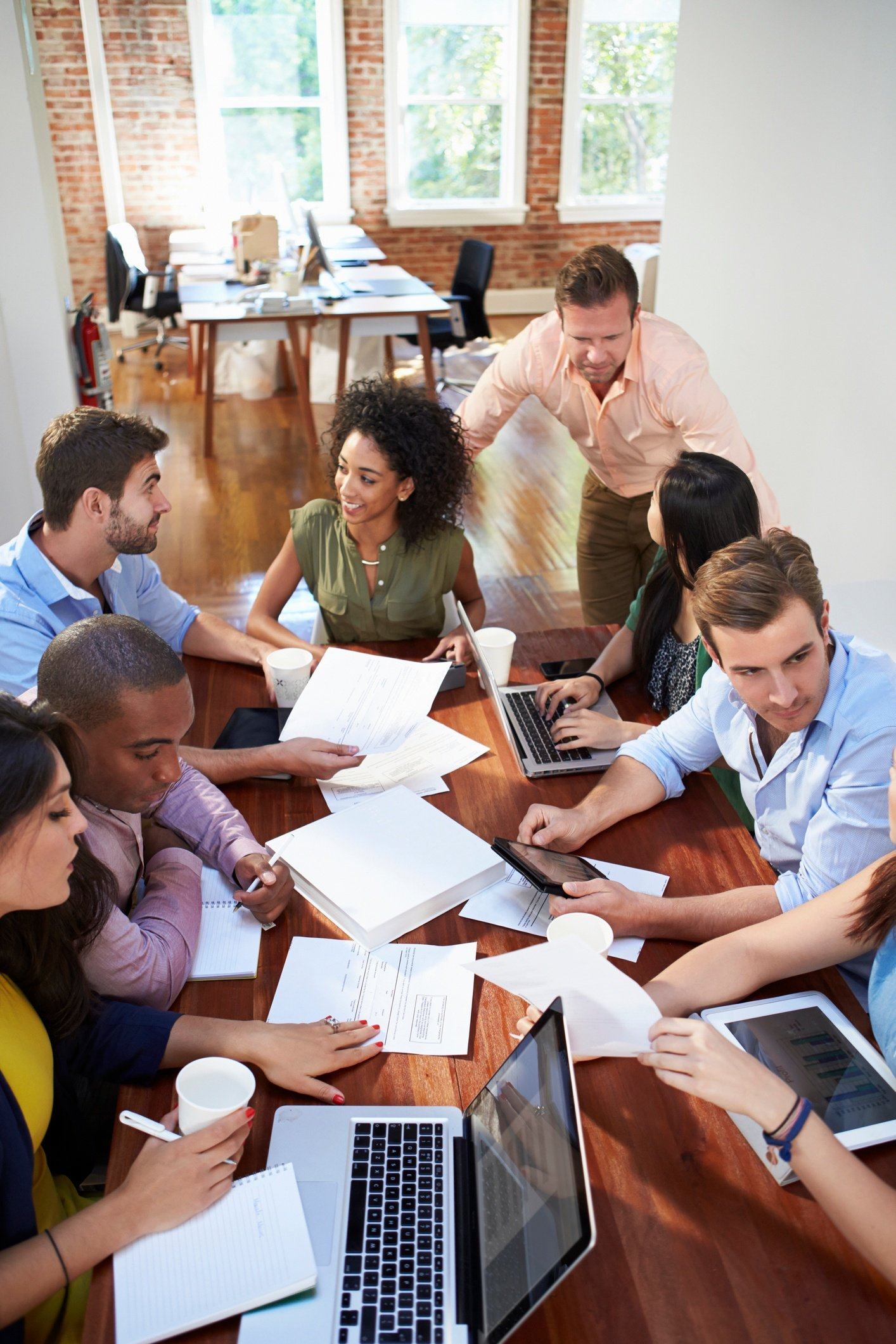 Group of office workers meeting to discuss their ideas