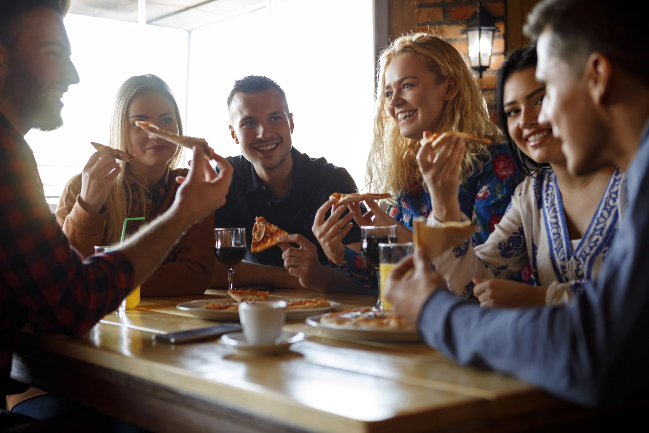 Group of friends having pizza