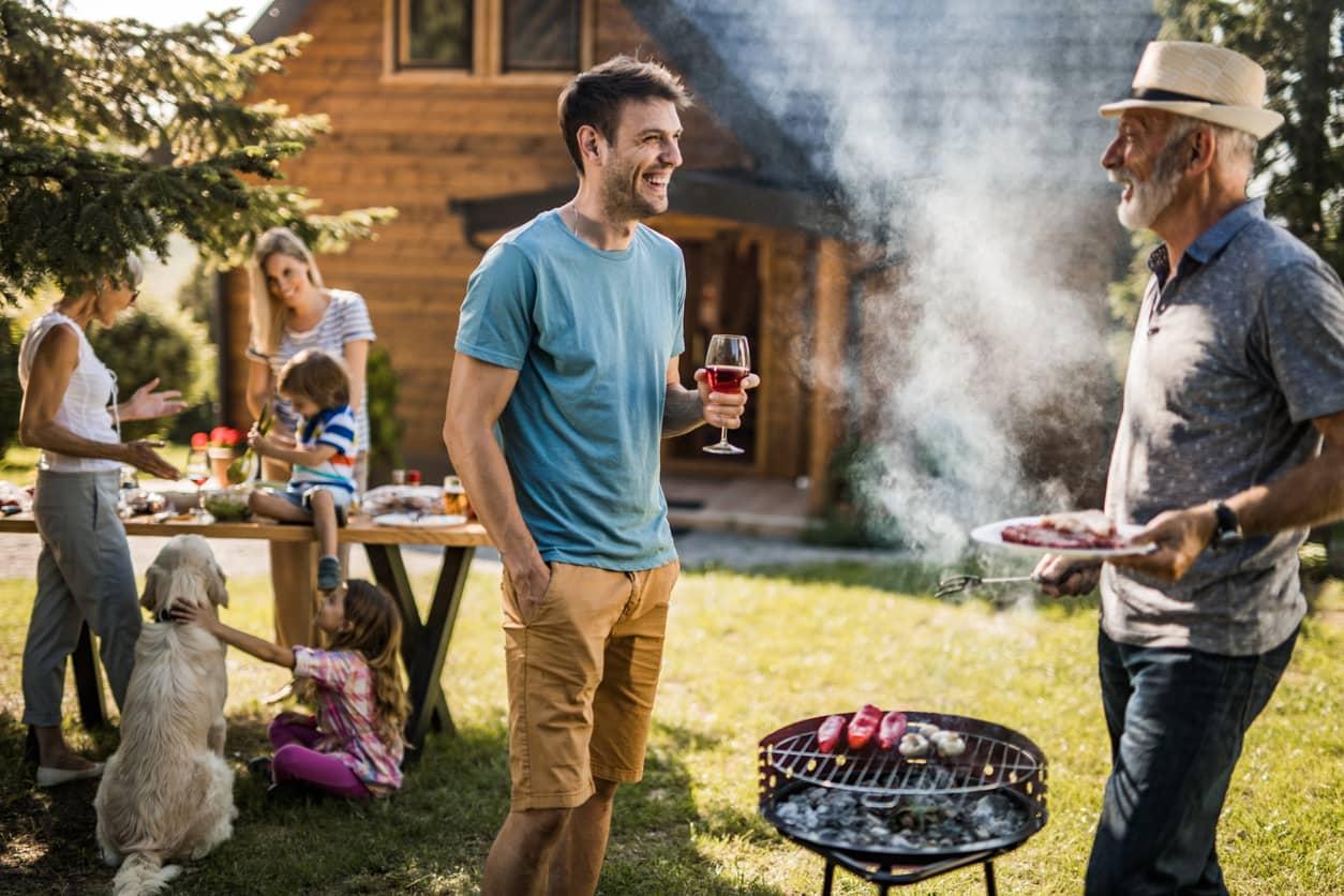 A family enjoying a backyard barbecue