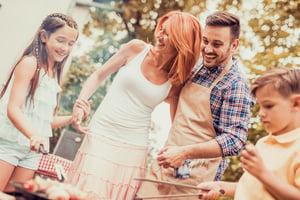 Young family having a fun barbecue