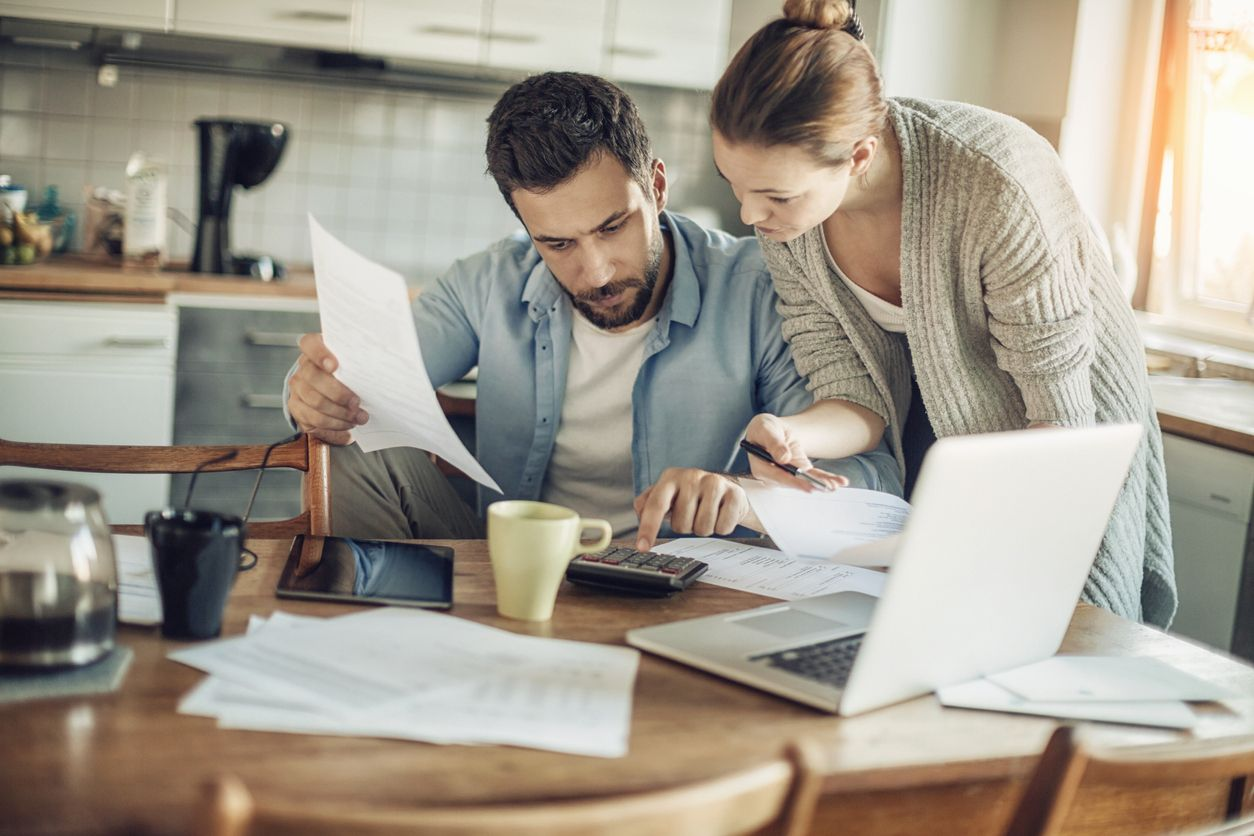 A couple budgeting and planning to buy a house