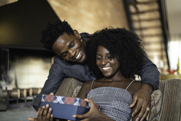 A husband gives his wife a gift exercising the love language of gifts