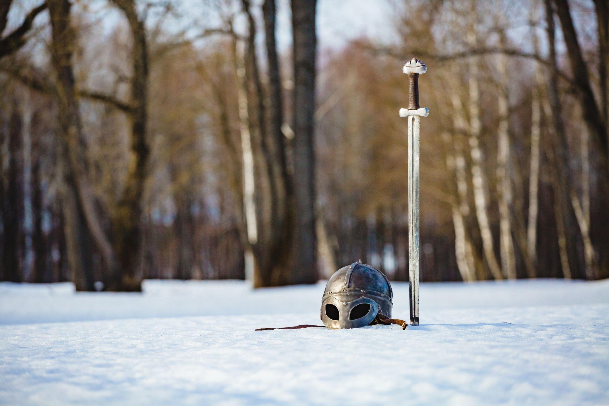 Sword and helmet in the snow