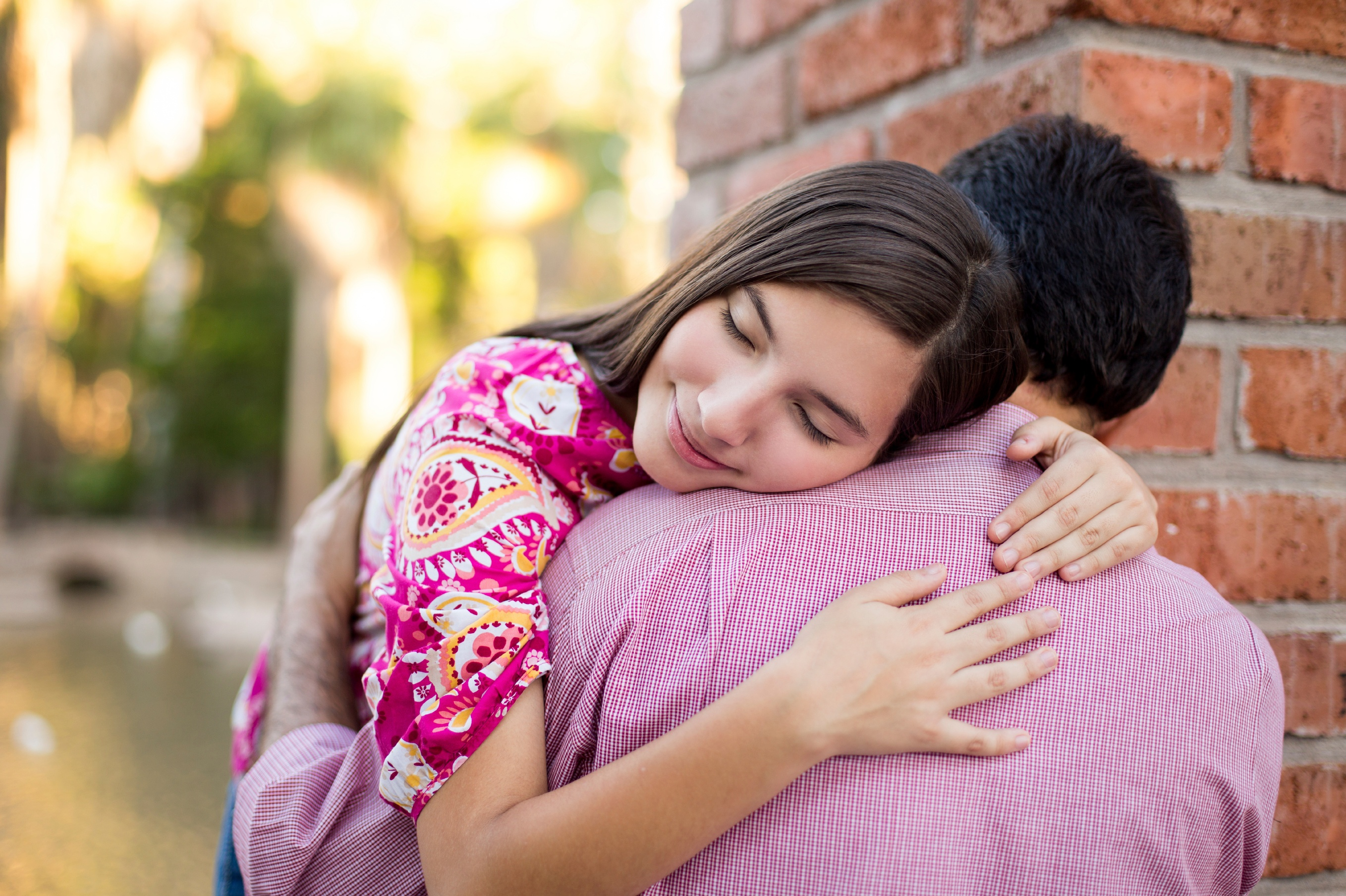Young girl hugging her father with gratitude