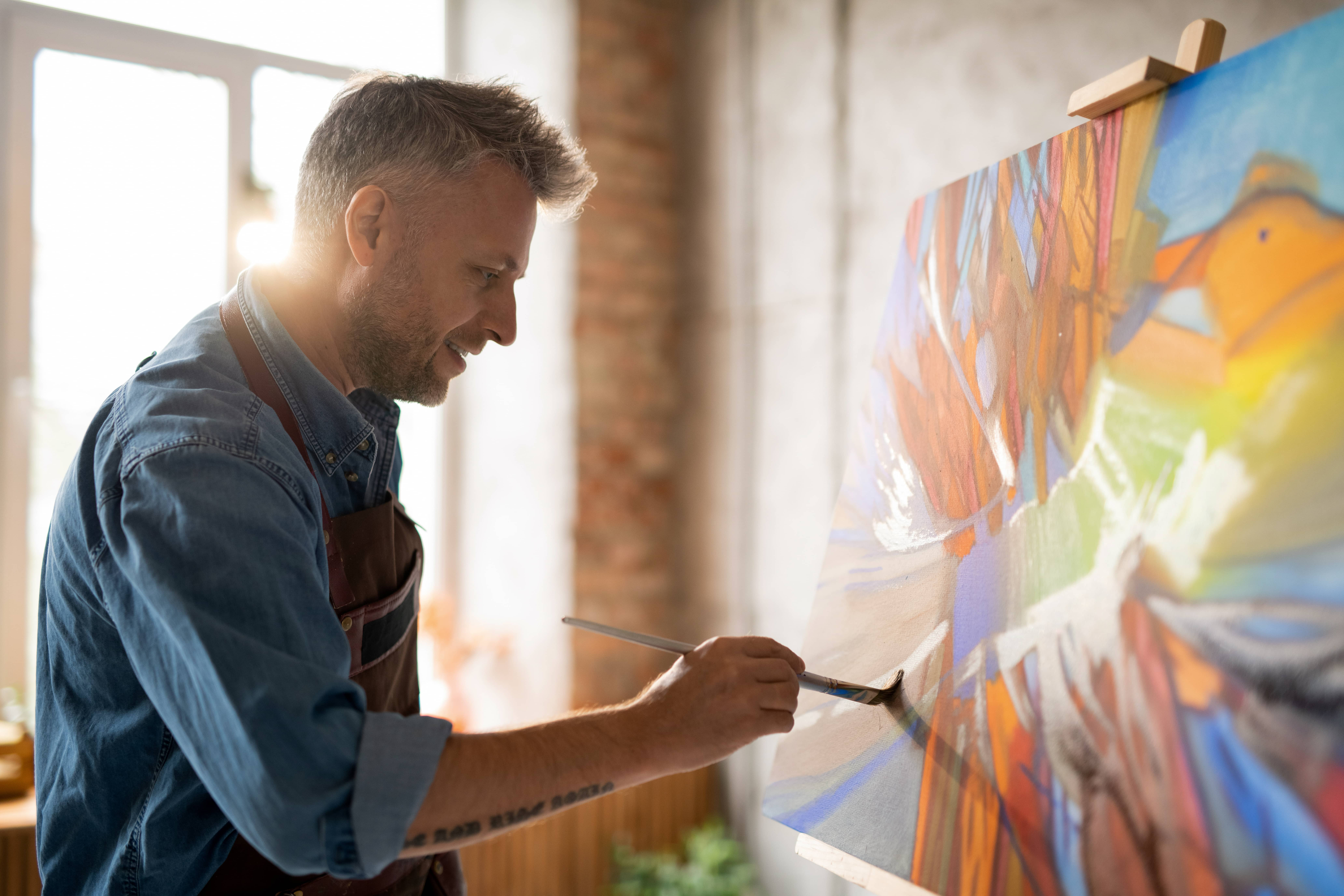 A man painting and spending slow time alone