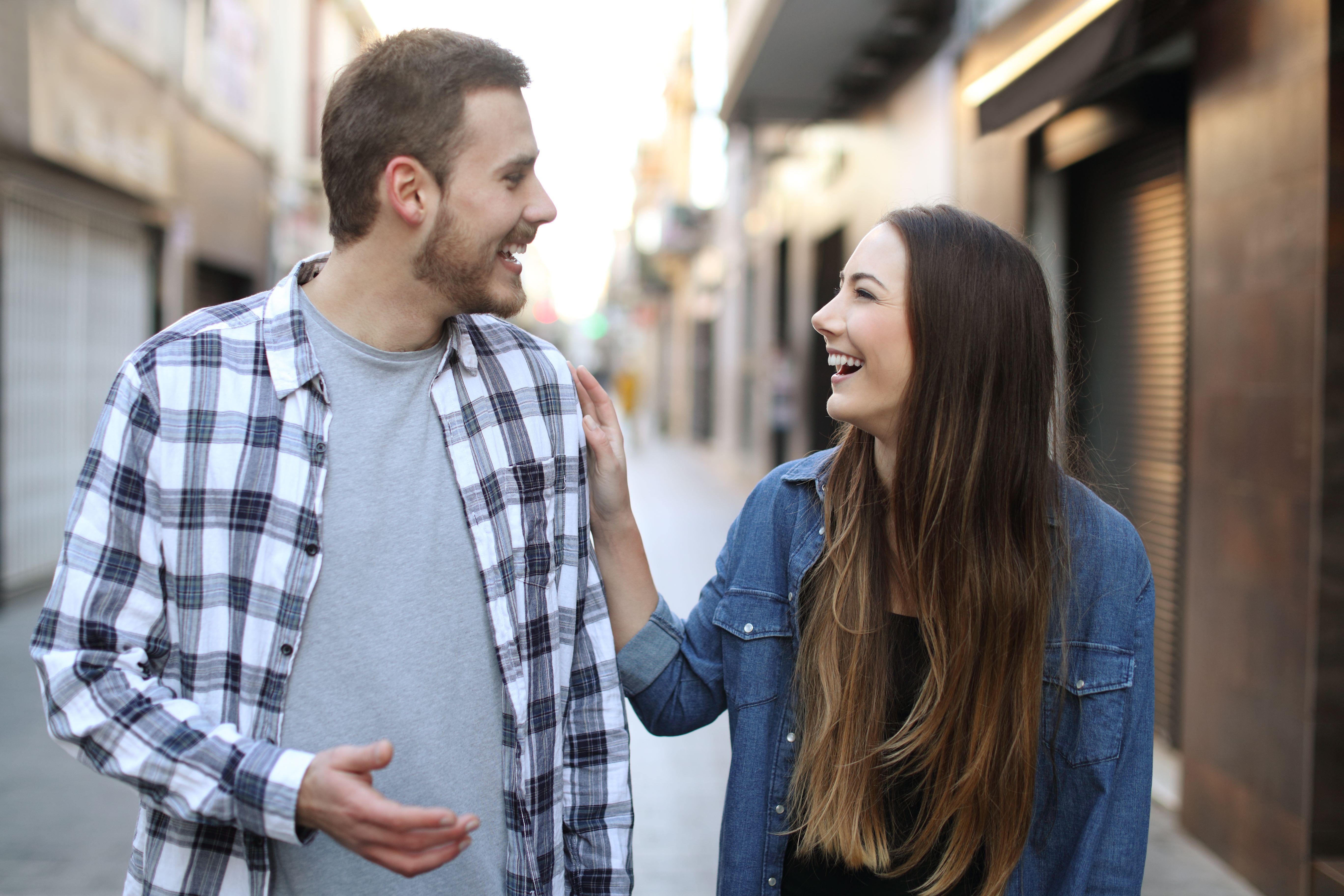 Man and woman conversing while walking