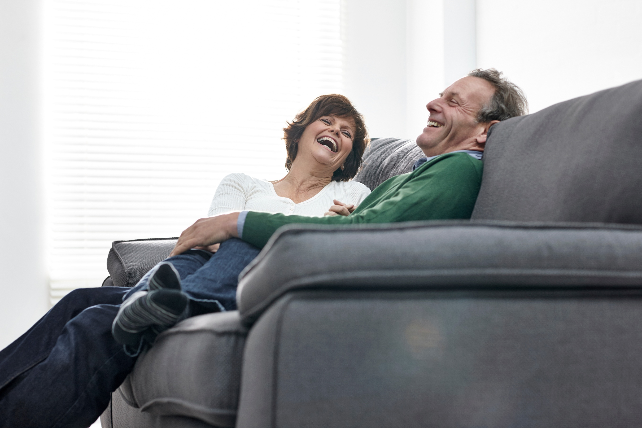 Married couple talking and laughing