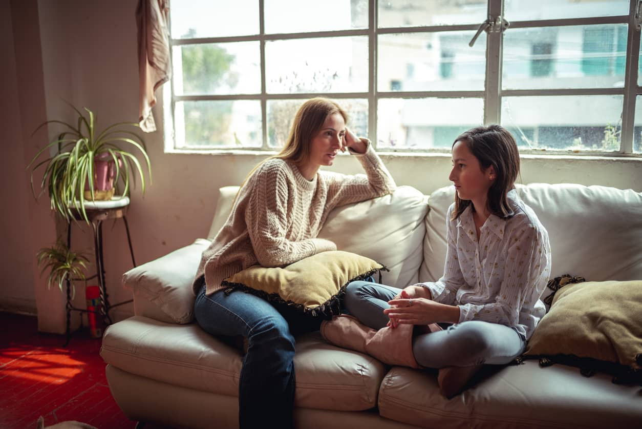 Mother having a conversation with her daughter about negative self-talk