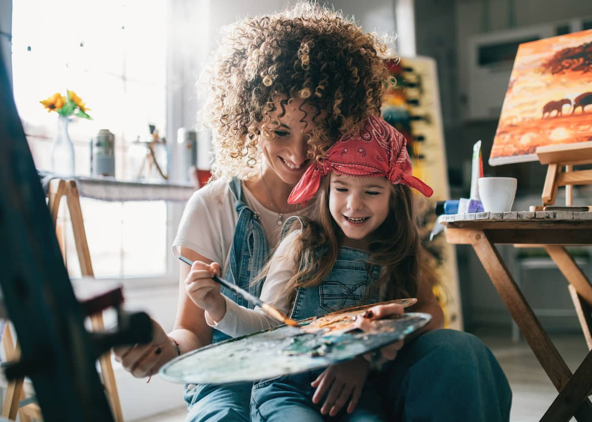 Mother and daughter exploring colors and painting