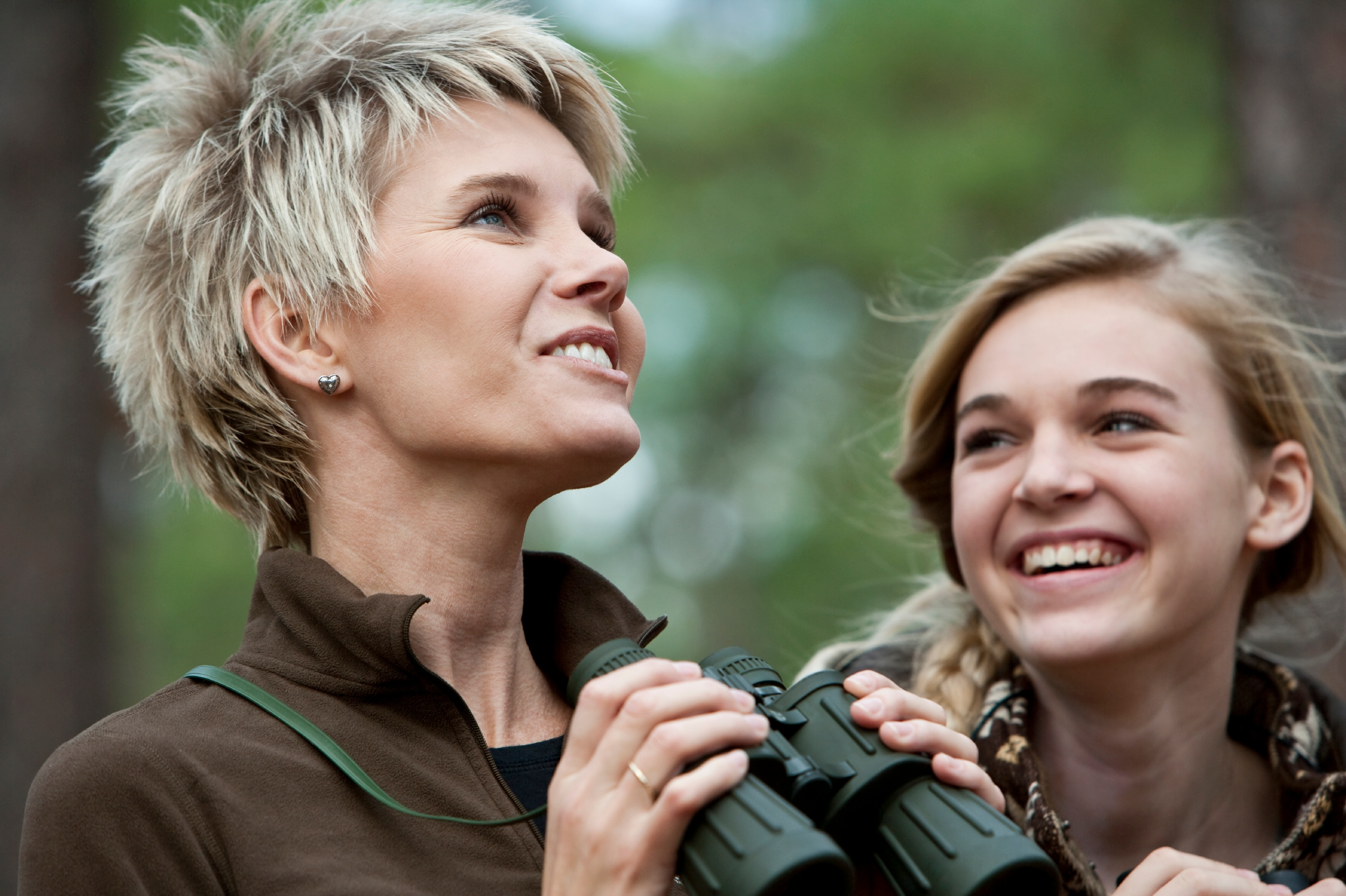Mother-and-teen-daughter-enjoying-scenic-view-with-binoculars-000015544225_Large.jpg