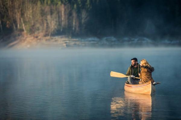 Couple adventuring on a lake