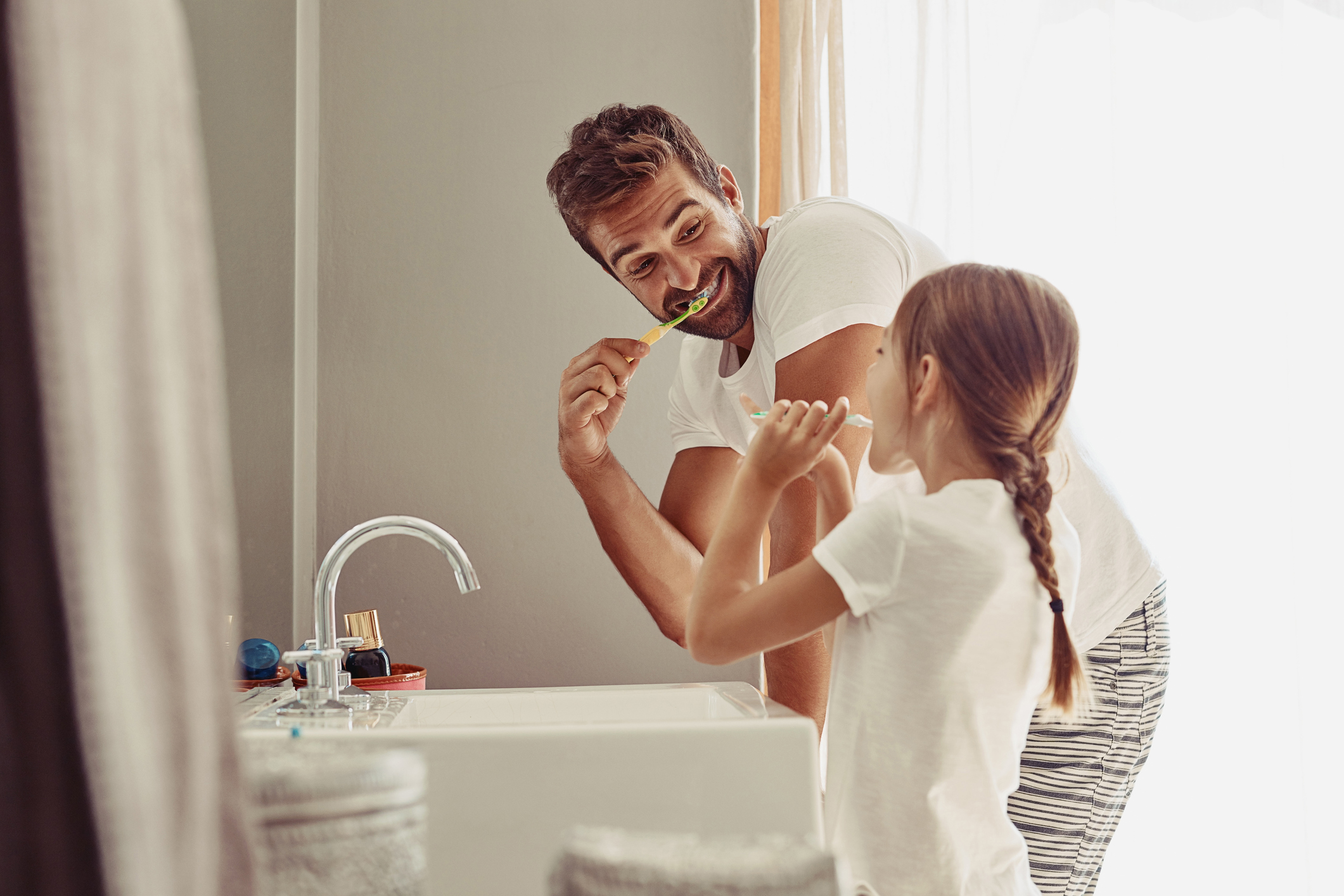 A father and daughter brushing their teeth and making memories