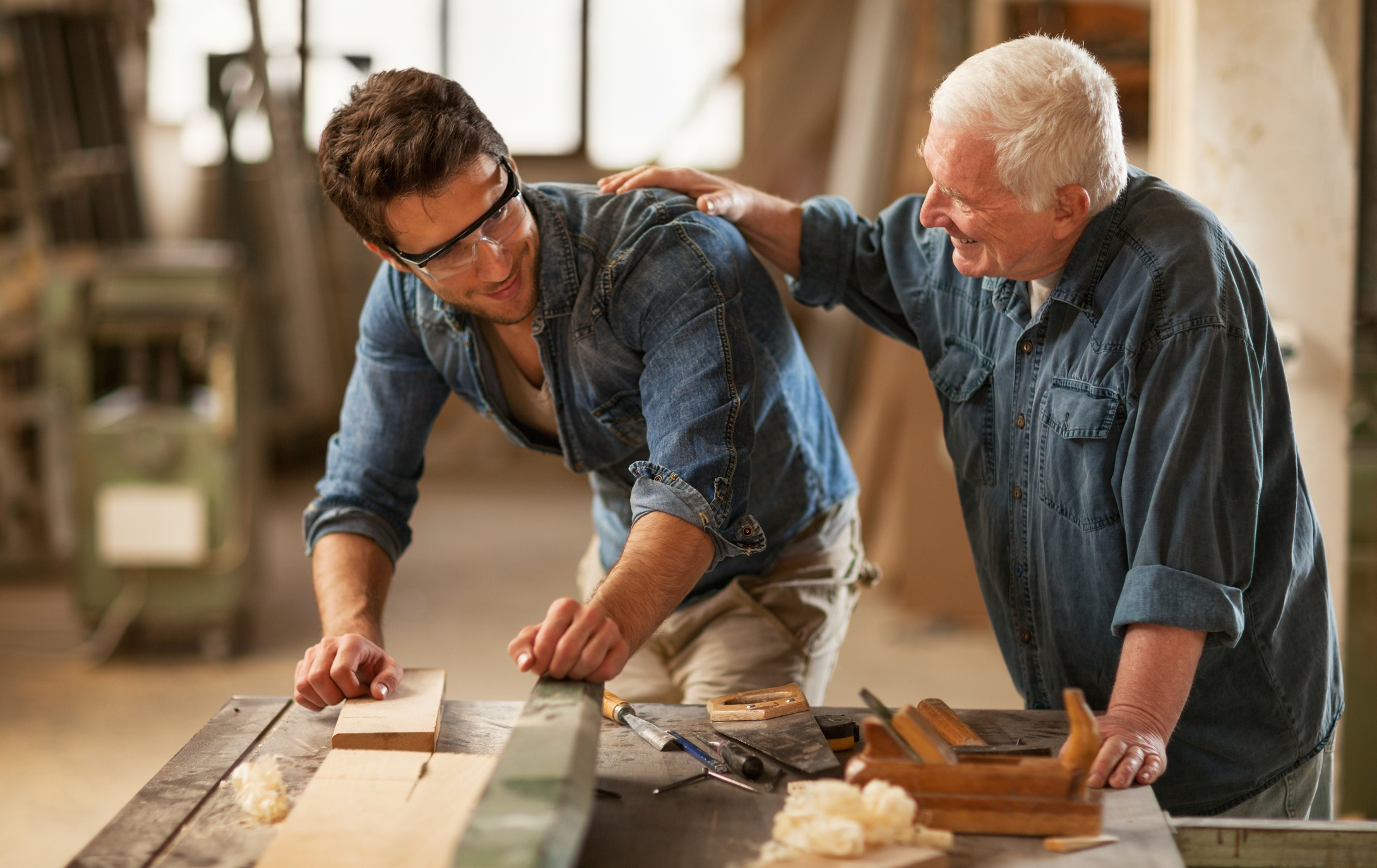 Photo-of-a-senior-carpenter-and-apprentice-at-work-180827934_2182x1376.jpeg