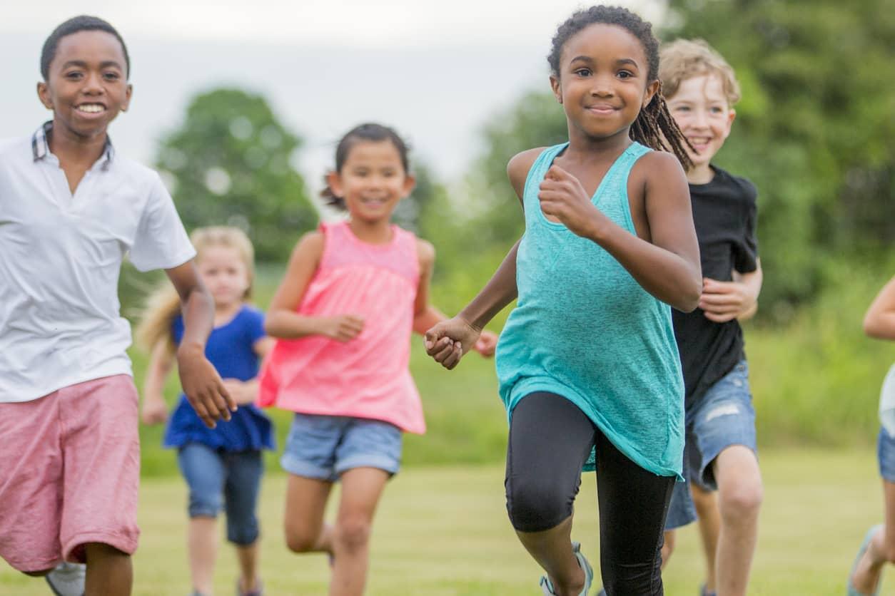 Children running to greet newcomers