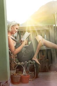 Woman reading in a self-care nook