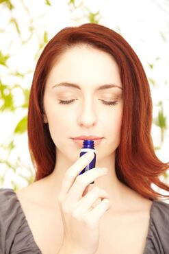 Relaxed-redhead-woman-smelling-essential-oil-with-eyes-closed-184591618_1415x2122.jpeg