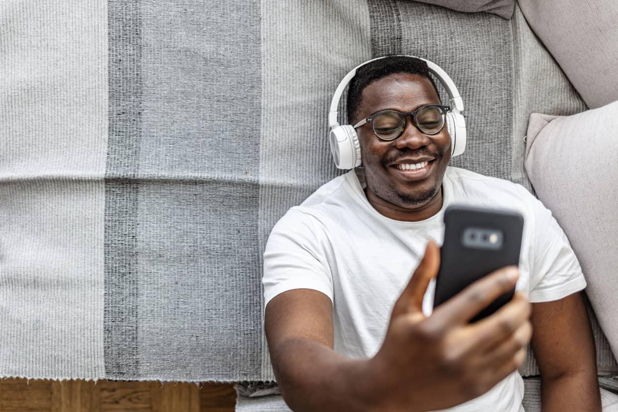 Black man rocking his studies with music