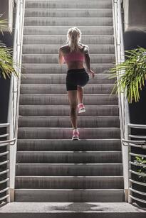 A woman taking a break to run stairs