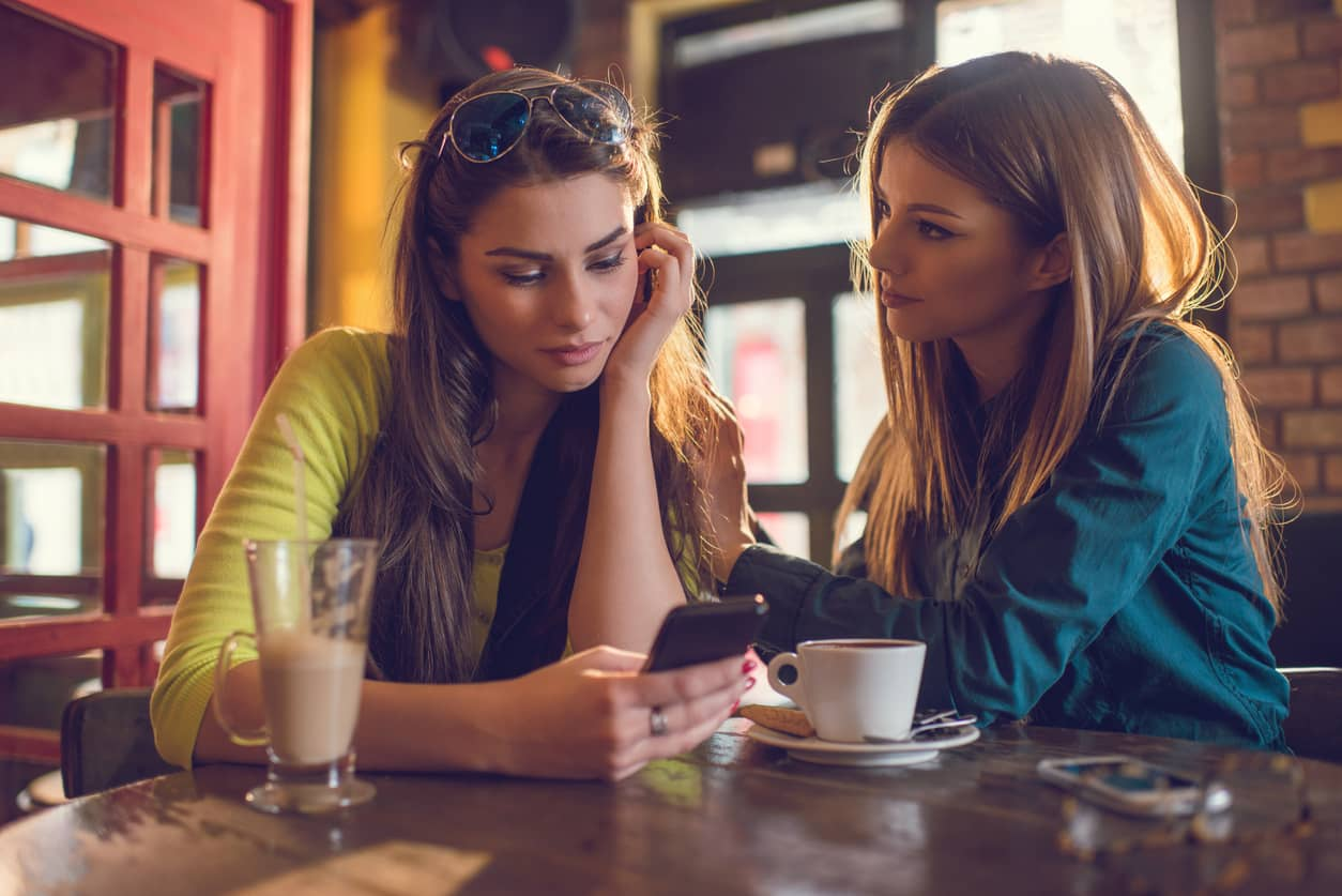 A woman empathizing with a friend