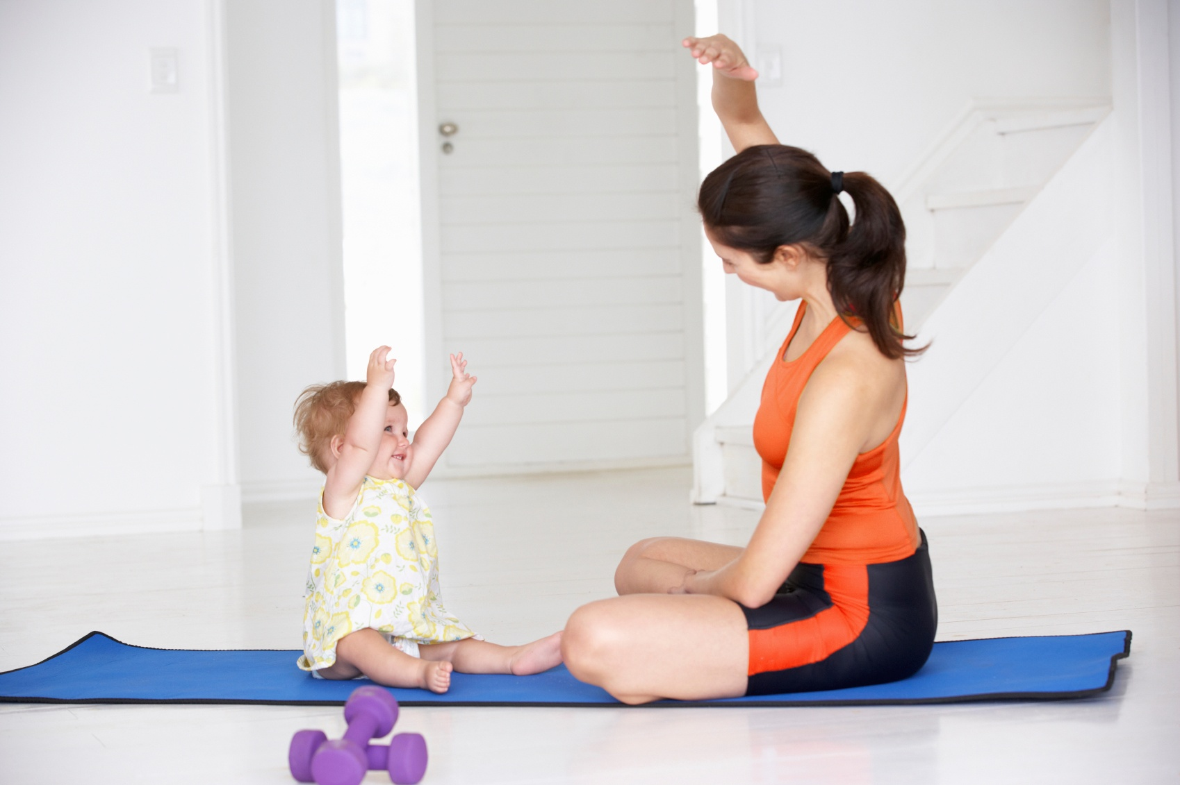 Mom and toddler exercising