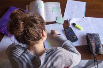 Teenager-doing-homework-902176156_2125x1416-compressor