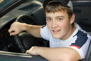 Teenager behind the wheel of his first car