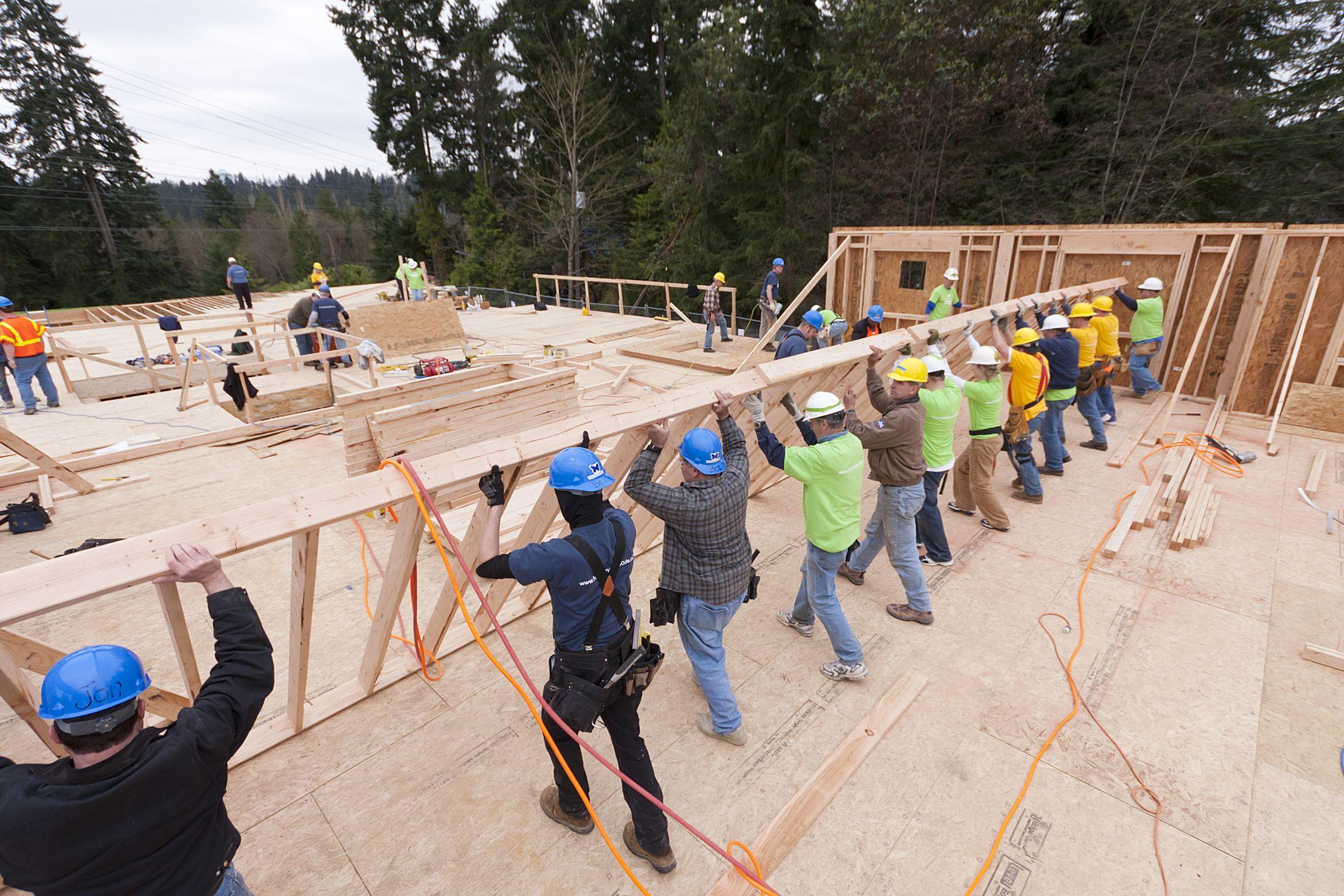 Volunteers help rebuild homes lost in natural disasters